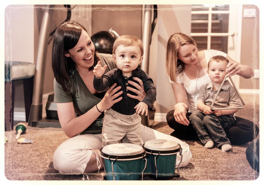 Mothers playing instruments with their children.
